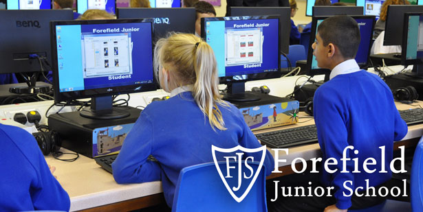 Pupil sat at desk using custom branded Forefield Junior School VeryPC Broadleaf Access desktop PC